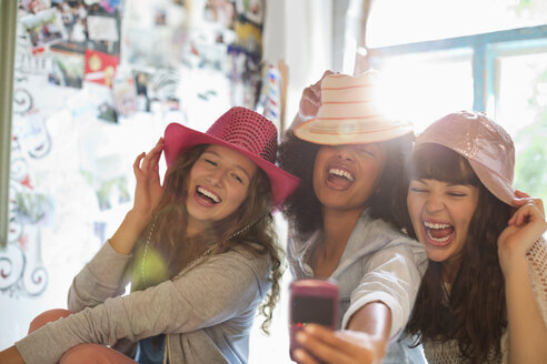 Women wearing hats in bedroom - CAIF03103