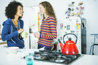 Women talking in kitchen - CAIF03118