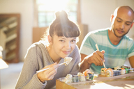 Couple eating sushi together - CAIF03139