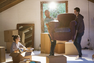 Friends moving furniture in new home - CAIF03190