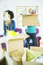 Couple unpacking boxes in new home - CAIF03202