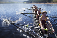 Rowing team rowing scull on lake - CAIF03238