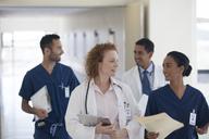 Hospital staff talking in hallway - CAIF03283