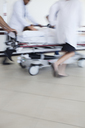 Hospital staff rushing patient to operating room - CAIF03292