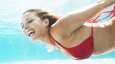 Woman swimming in pool - CAIF03298