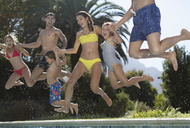 Family jumping into swimming pool - CAIF03301