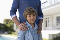 Father and son standing outdoors - CAIF03337