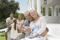 Older couple smiling on porch - CAIF03409