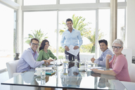 Business people smiling in meeting - CAIF03490