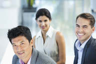 Business people smiling in office - CAIF03508