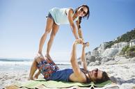 Portrait of playful couple on beach - CAIF03529