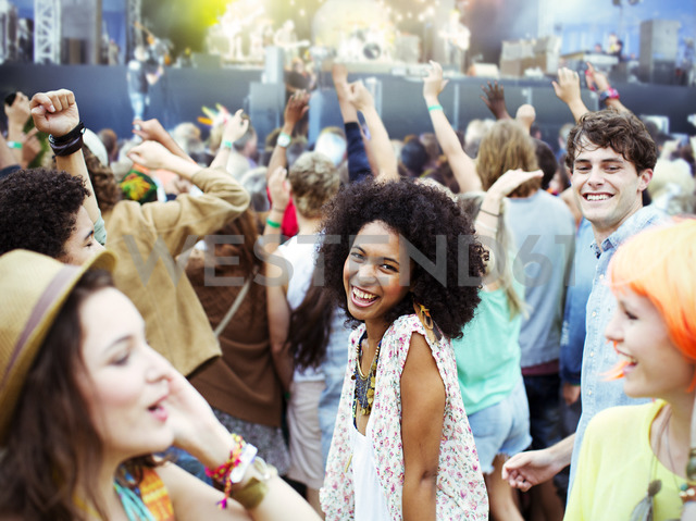 Fans dancing and cheering at music festival - CAIF03637