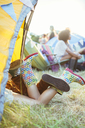 CoupleÍs legs sticking out of tent at music festival - CAIF03643
