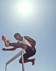 Track and field athlete clearing hurdle - CAIF03727
