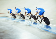 Track cycling team riding around velodrome - CAIF03742