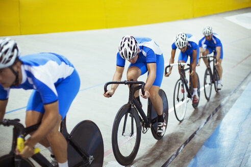 Track cycling team riding in velodrome - CAIF03745
