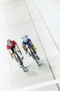 Track cyclists racing in velodrome - CAIF03754
