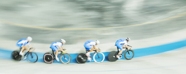 Track cycling team racing in velodrome - CAIF03763