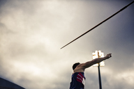 Track and field athlete throwing javelin - CAIF03784