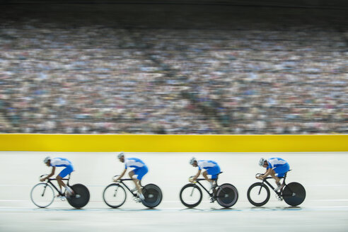 Track cycling team riding in velodrome - CAIF03811
