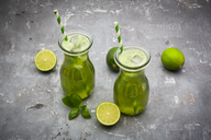 Two glasses of organic lime lemonade with basil - LVF06755