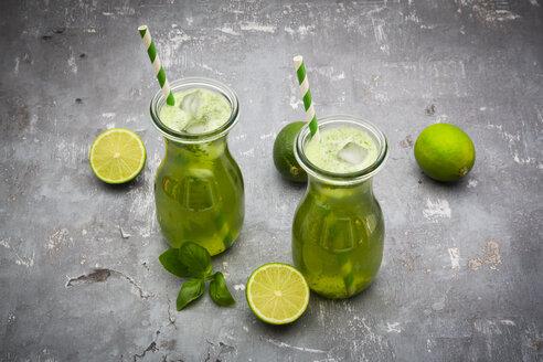 Two glasses of organic lime lemonade with basil - LVF06755