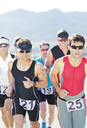 Runners in race on rural road - CAIF03818