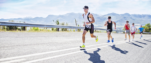 Runners in race on rural road - CAIF03833
