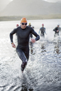 Triathletes emerging from water - CAIF03842
