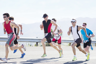 Runners in race on rural road - CAIF03845