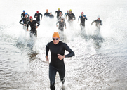 Triathletes emerging from water - CAIF03866