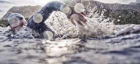 Triathletes swimming in race - CAIF03872