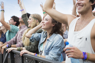 Fans cheering at music festival - CAIF03902