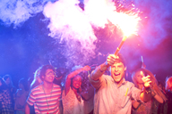 Fans with fireworks at music festival - CAIF03920