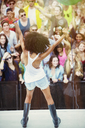 Fans cheering for woman performing on stage - CAIF03971