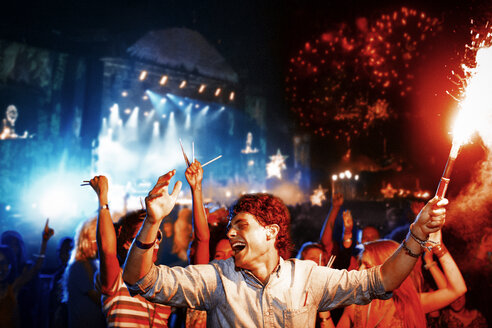 Fans with fireworks at music festival - CAIF03986