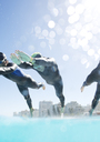 Triathletes diving into swimming pool - CAIF04062