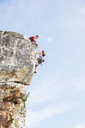Climbers scaling steep rock face - CAIF04080