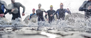 Triathletes emerging from water - CAIF04086