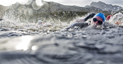 Swimmers splashing in water - CAIF04098