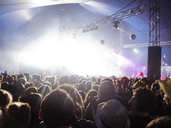 Fans facing illuminated stage at music festival - CAIF04119
