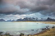 Mountain view behind ocean, Lofoten, Norway - CAIF04191