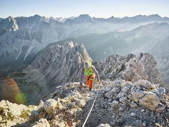 Austria, Tyrol, Innsbruck, mountaineer at Nordkette via ferrata - CVF00238