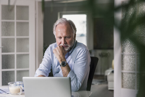 Portrait of mature man using laptop at home - UUF12937