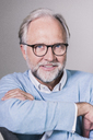 Portrait of mature man with and grey hair and beard wearing glasses - UUF12949