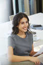 Smiling businesswoman working in conference room - HOXF00118