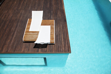 Lounge chairs and swimming pool - CAIF04417