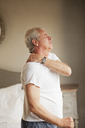 Senior man holding shoulder in pain - CAIF04435