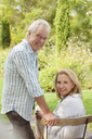 Portrait of smiling senior couple in garden - CAIF04534