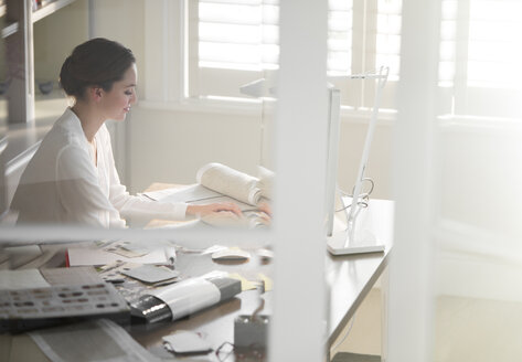 Interior designer working at computer in home office - HOXF00214